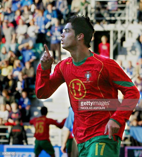 Portugal's Cristiano Ronaldo celebrates after scoring the opening goal during Portugal vs Estonia World Cup 2006 qualifier football match at the A le...