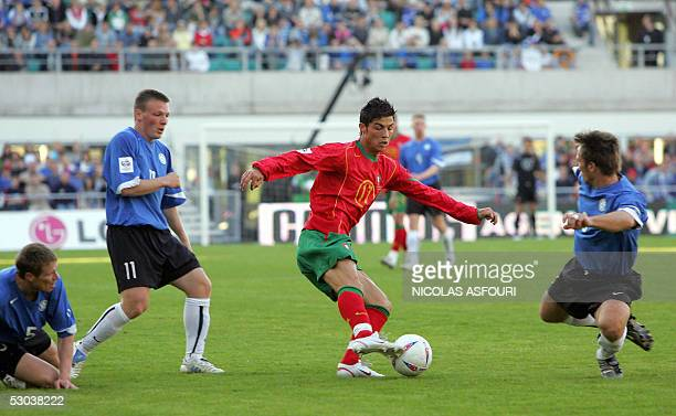 Portugal's Cristiano Ronaldo vies with Estonia's Urmas Rooba and Dmitri Kruglov and Martin Reim during their World Cup 2006 qualifier football match...