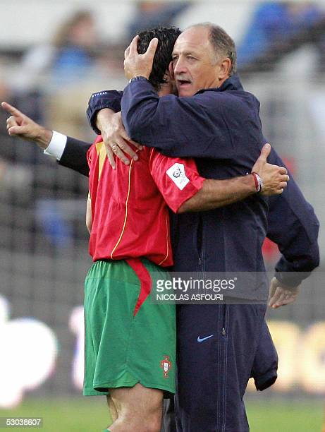 Portugal's Luis Figo is embrassed by Portugal's national coach Luiz Felipe Scolari at the end of their World Cup 2006 qualifier football match at the...