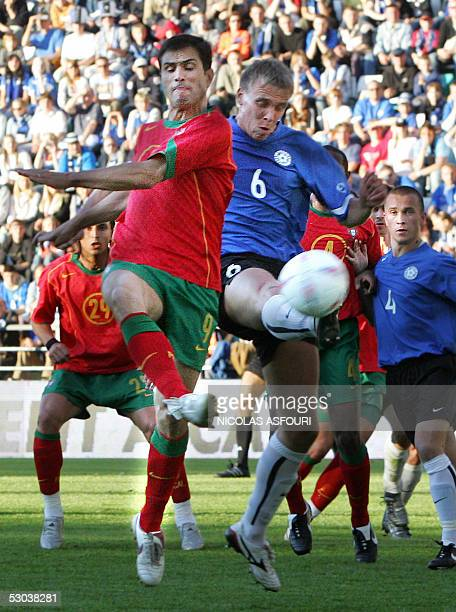 Portugal's Pauleta vies with Estonia's Taavi Rahn during their World Cup 2006 qualifier football match at the A le Coq Arena in Tallinn 08 June 2005...