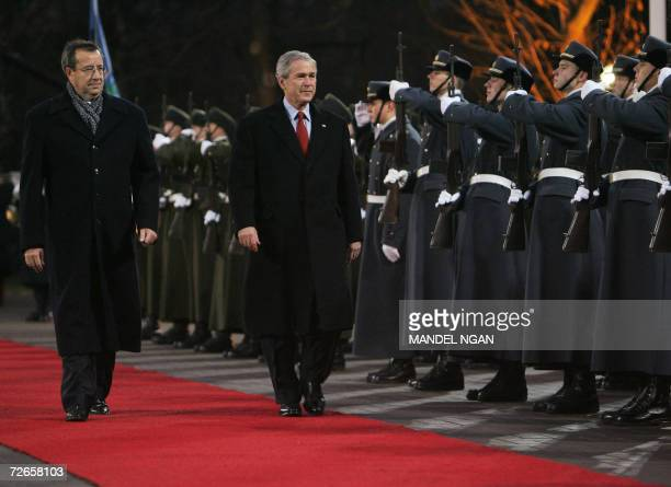 US President George W Bush and Estonias President Toomas Hendrik Ilves inspect the honour guard 28 November 2006 during a welcome ceremony at...
