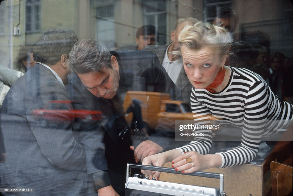 Tallinn, Estonia-During the Soviet occupation, Russians are being given a product demonstration by an Estonian shopkeeper.; 1996:10:01