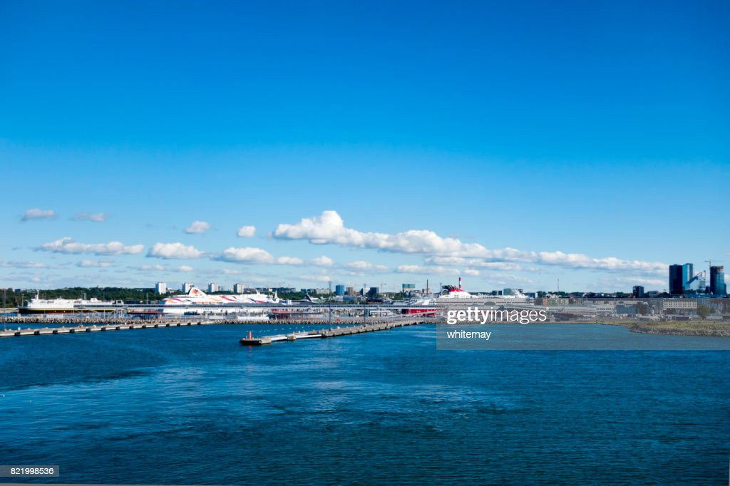 Tallinn harbour and skyline with ferries : Stock Photo