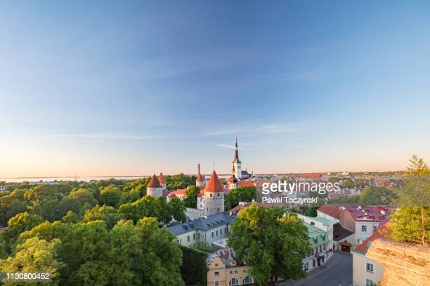 tallinn's old town with st olaf's church's spire towering above it, estonia - torenspits stockfoto's en -beelden