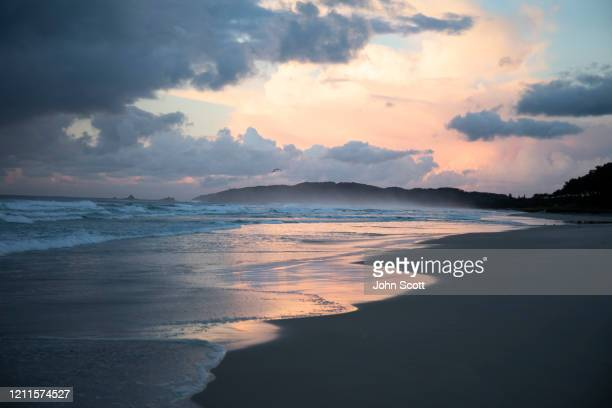 tallow beach, byron bay at dawn - moody sky stock pictures, royalty-free photos & images