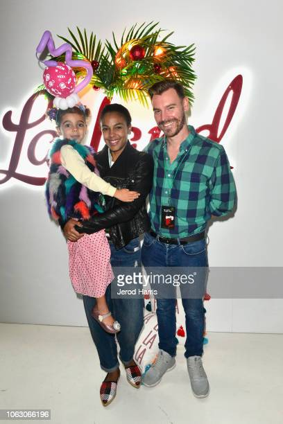 Tallulah Anais Sykes Marsha Thomason and Craig Sykes attend the Fa La Land VIP preview at ROW DTLA on November 17 2018 in Los Angeles California