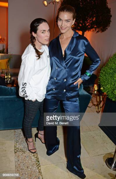 Tallulah Harlech and Arizona Muse attend Goga Ashkenazi's celebration of the 'Sustainable Surf' collaboration with Marc Quinn with dinner at her...