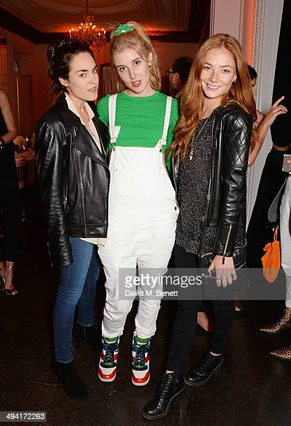 Tallulah Harlech Paula Goldstein and Clara Paget attend the FRAME Denim dinner hosted by Hanneli Mustaparta at Il Bottaccio on May 28 2014 in London...