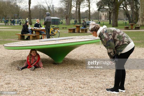 Tallulah sits on the ground as her mum Shannon tells her it's time to go at Victoria Park playground on March 6, 2021 in London, England. Londoners...