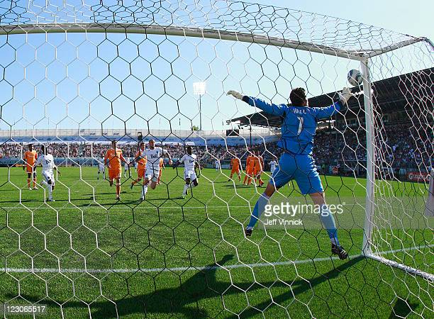 Tally Hall of the Houston Dynamo watches a Vancouver shot hit the goalpost during their MLS game against the Vancouver Whitecaps FC August 27 2011 at...
