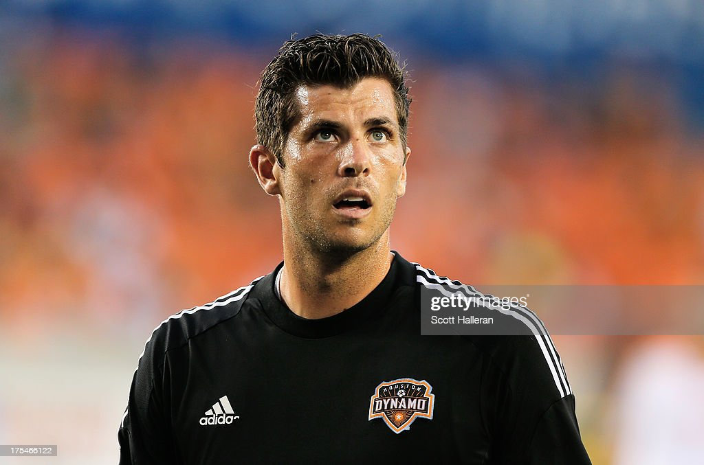 Tally Hall #1 of the Houston Dynamo works out on the field before the game against the Chicago Fire at BBVA Compass Stadium on July 27, 2013 in Houston, Texas.