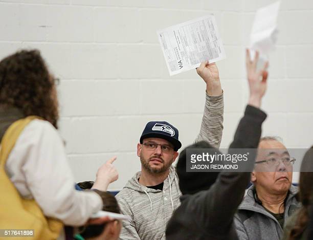 A tally of candidate votes is taken as people participate in Washington State Democratic Caucuses at Martin Luther King Elementary School in Seattle...