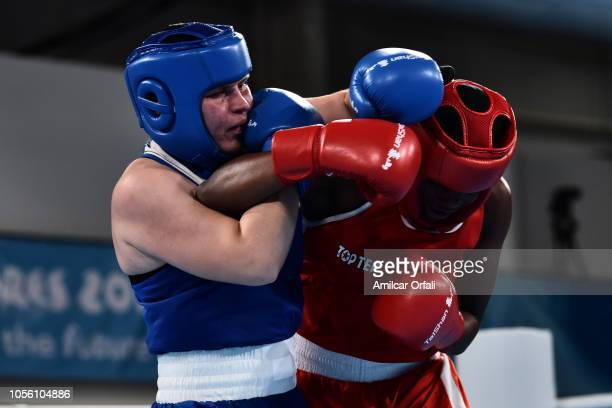 Tallya Brixaux of France fights with Anastasiia Shamonova of Russia in Women's Middle Gold Medal Bout during day 11 of Buenos Aires 2018 youth...