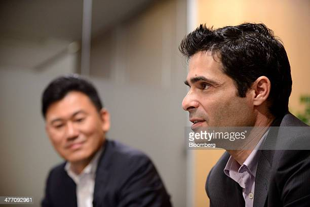 Talmon Marco cofounder and chief executive officer of Viber Media Ltd right speaks as Hiroshi Mikitani chairman and chief executive officer of...