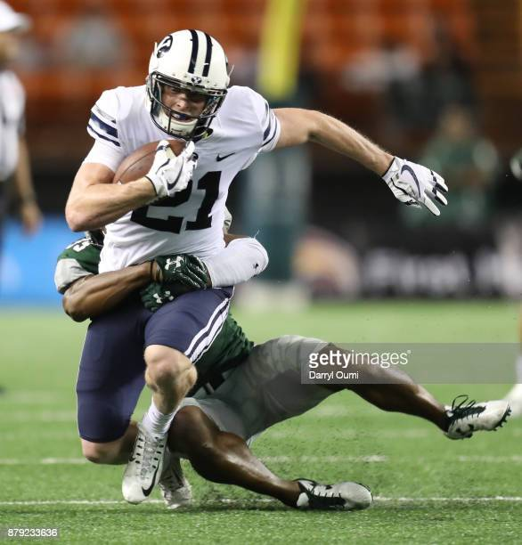 Talon Shumway of the BYU Cougars stacked by Trayvon Henderson of the Hawaii Rainbow Warriors during the second half of their game at Aloha Stadium on...