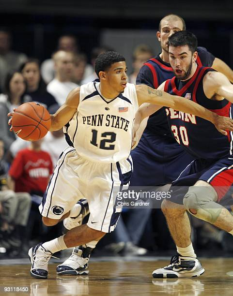 Talor Battle of the Penn State Nittany Lions dribbles the ball against Rob Belcore of the Penn Quakers at the Bryce Jordan Center on November 13 2009...