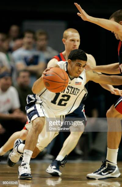 Talor Battle of the Penn State Nittany Lions drives around Mike Howlett of the Penn Quakers at the Bryce Jordan Center on November 13 2009 in State...
