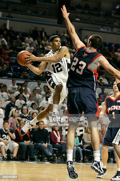 Talor Battle of the Penn State Nittany Lions drives to the basket against Mike Howlett of the Penn Quakers at the Bryce Jordan Center on November 13...