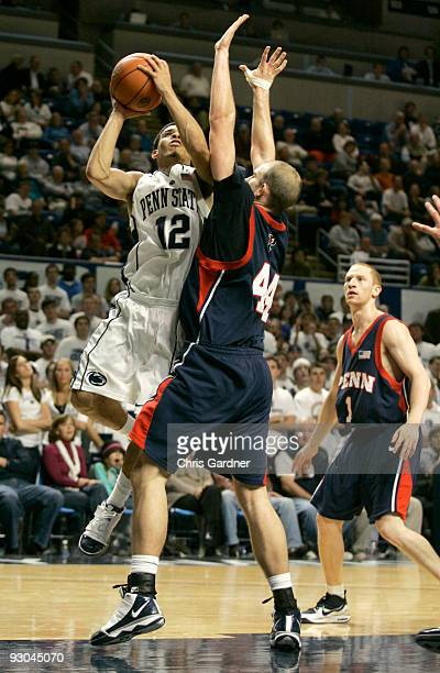 Talor Battle of the Penn State Nittany Lions drives to the basket against Conor Turley of the Penn Quakers at the Bryce Jordan Center on November 13...