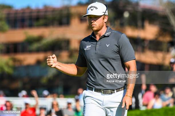 Talor Gooch celebrates and pumps his fist after making a birdie putt on the 13th hole green during the final round of the Farmers Insurance Open on...
