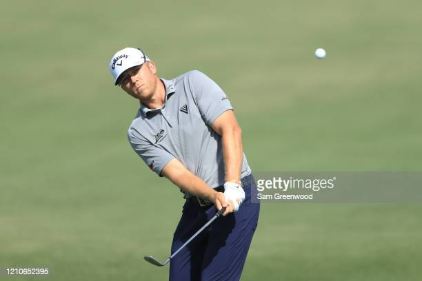 Talor Gooch of the United States chips during the first round of the Arnold Palmer Invitational Presented by MasterCard at the Bay Hill Club and...