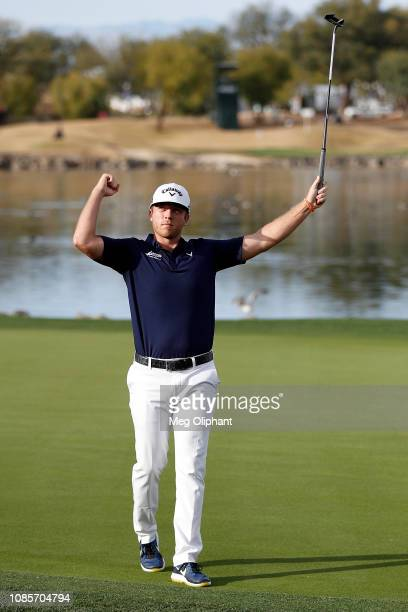 Talor Gooch of the United States reacts after making a birdie on the 18th hole during the final round of the Desert Classic at the Stadium Course on...