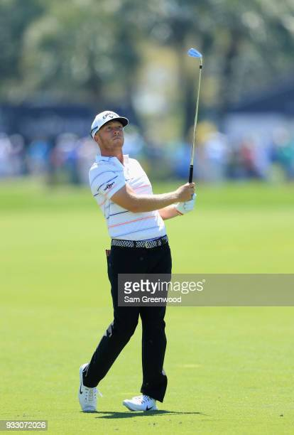 Talor Gooch plays his shot on the first hole during the third round at the Arnold Palmer Invitational Presented By MasterCard at Bay Hill Club and...