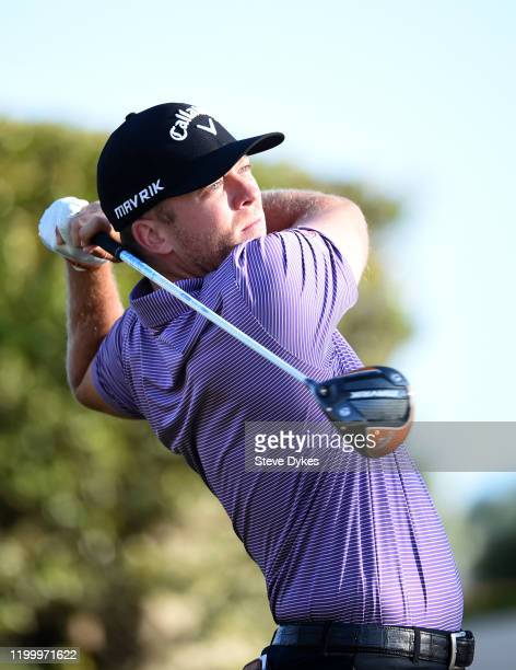 Talor Gooch plays his shot on the second hole during the first round of The American Express tournament at the Jack Nicklaus Tournament Course at PGA...