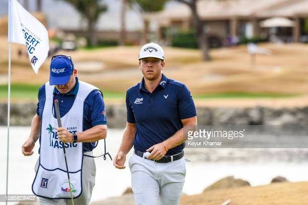 Talor Gooch walks off the 10th hole green during the final round of the Desert Classic on the Stadium Course at PGA West on January 20 2019 in La...