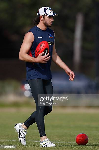 Talor Walker walks with a ball during an Adelaide Crows AFL training session Max Basheer Reserve on July 24 2012 in Adelaide Australia