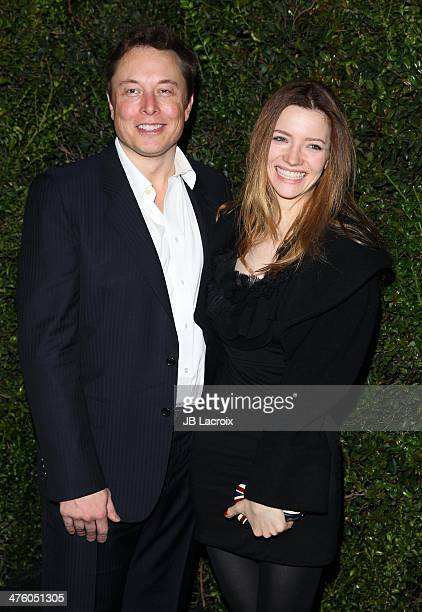 Talulah Riley and Elon Musk attend the Chanel Charles Finch PreOscar Dinner held at Madeo Restaurant on March 1 2014 in Los Angeles California