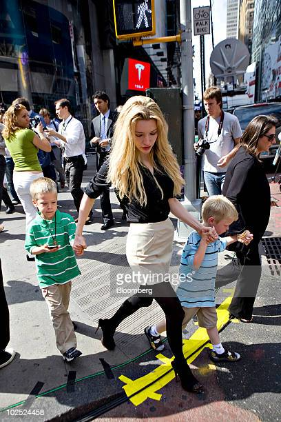 Talulah Riley, fiancee of Elon Musk, chairman and chief executive officer of Tesla Motors, walks with Musk's twin boys Griffin, left, and Xavier,...