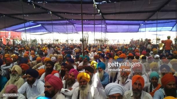Talwandi Sabo MLA Baljinder Kaur addressing the gathering at Bargari in Faridkot on Friday while Sukhpal Khaira Simranjeet Singh Mann Chief...