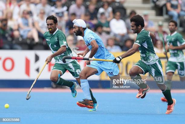 Talwinder Singh of India is closed down by Ali Shan of Pakistan and Tasawar Abbas of Pakistan during the 5th8th place match between Pakistan and...