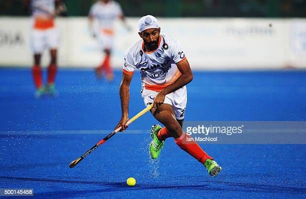 Talwinder Singh of India runs with the ball during the match between India and Belgium on day nine of The Hero Hockey League World Final at the...