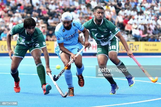 Talwinder Singh of India tangles with Muhammad Aleem Bilal of Pakistan and Muhammad Yaqoob of Pakistan during the Hero Hockey World League Semi Final...