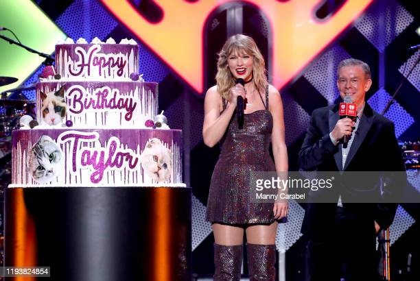 Talyor Swift and Elvis Duran speak onstage during iHeartRadio's Z100 Jingle Ball 2019 at Madison Square Garden on December 13, 2019 in New York City.
