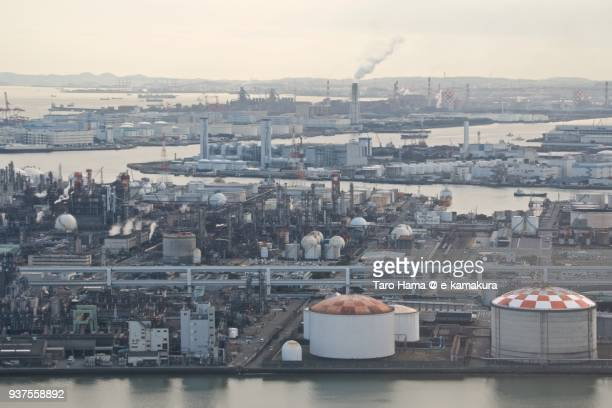 tama rive, tokyo bay, oil stockpile bases and chimneys factory area in kawasaki city in kanagawa prefecture in japan daytime aerial view from airplane - 川崎市 ストックフォトと画像