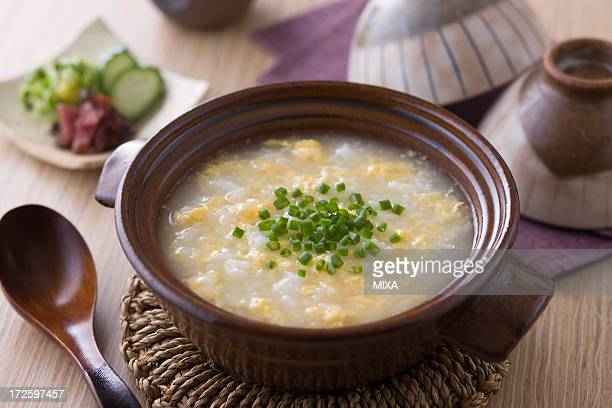 tamago-gayu - congee stock photos and pictures