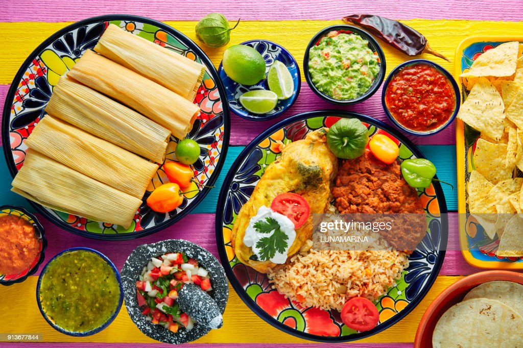Tamale with corn leaf and filled chili pepper : Stock Photo