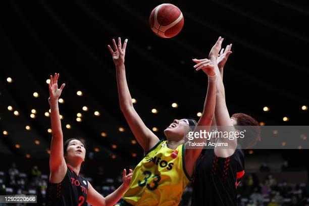 Tamami Nakada of ENEOS Sunflowers contests a rebound with Moeko Nagaoka and Miyuki Kawamura of Toyota Antelopes during the 87th Basketball Empress's...
