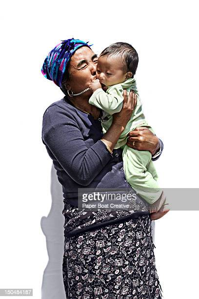 tamang grandmother in nepal holding a baby - kathmandu stock pictures, royalty-free photos & images