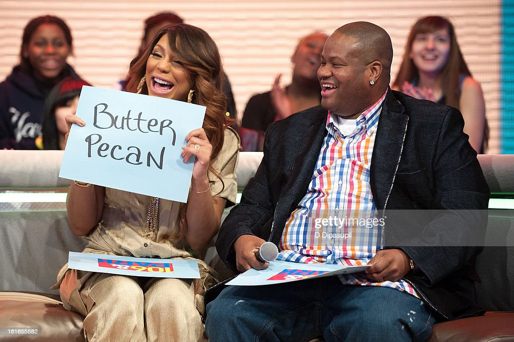 Tamar Braxton (L) and husband Vincent Herbert visit BET's '106 & Park' at BET Studios on February 13, 2013 in New York City.