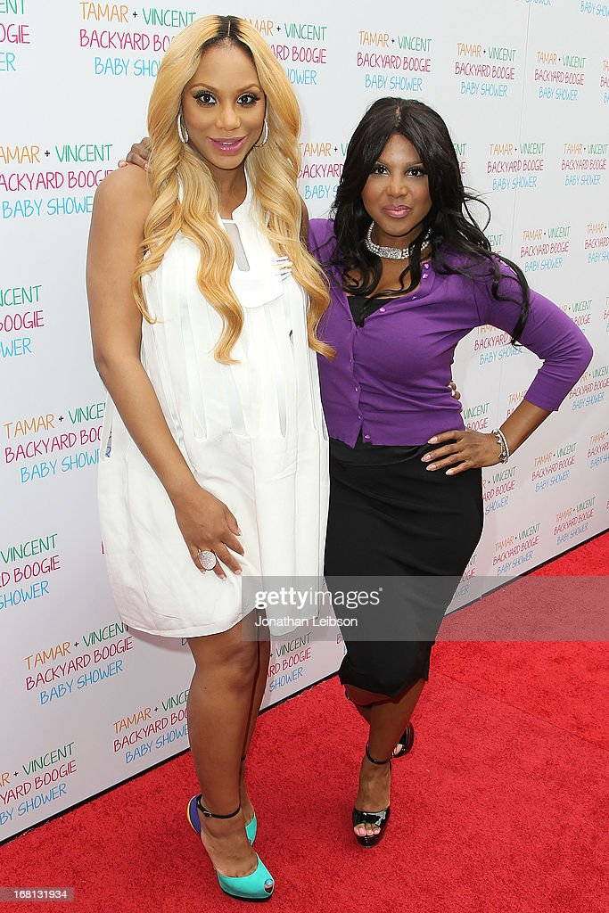 Tamar Braxton and Toni Braxton attend the Tamar Braxton Hosts Carnival-Themed Baby Shower With Friends And Family at Hotel Bel-Air on May 5, 2013 in Los Angeles, California.