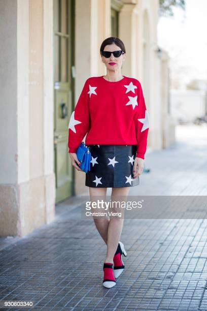 Tamar Karavan wearing skirt and knit with star print is seen during Tel Aviv Fashion Week on March 11 2018 in Tel Aviv Israel