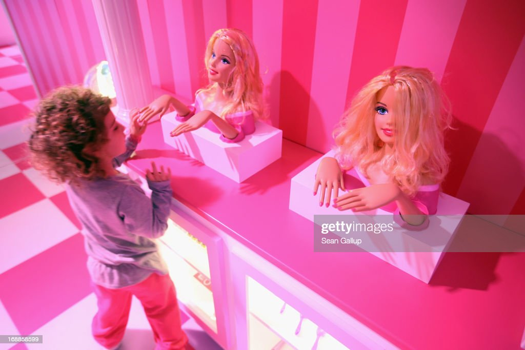 Tamar, 4, who is visiting with her mother from Israel, looks at Barbie busts at the Barbie Dreamhouse Experience on May 16, 2013 in Berlin, Germany. The Barbie Dreamhouse is a life-sized house full of Barbie fashion, furniture and accessories and will be open to the public until August 25 before it moves on to other cities in Europe.