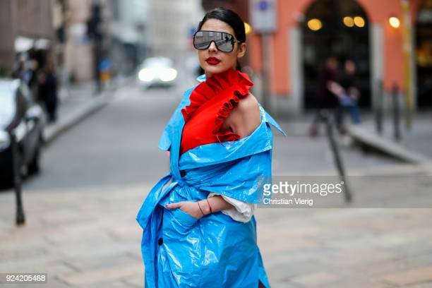 Tamara Al Gabbani wearing blue MSGM vinyl coat is seen outside MSGM during Milan Fashion Week Fall/Winter 2018/19 on February 25 2018 in Milan Italy