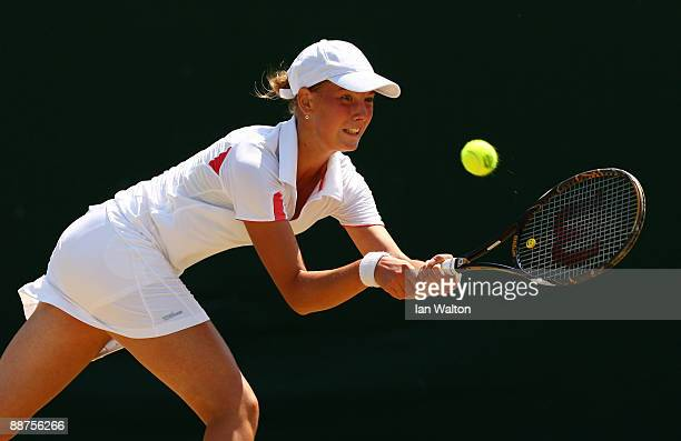 Tamara Curovic of Serbia plays a backhand during the girl's singles second round match against Beatrice Capra of USA on Day Eight of the Wimbledon...
