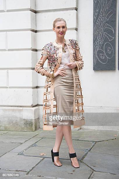 Tamara Dumas is wearing coat by Vilu Dan dress by Versace and shoes by Prada day 1 of London Womens Fashion Week Spring/Summer 2016 on September 16...