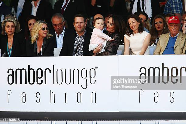 Tamara Ecclestone and her young daughter attend the Amber Fashion charity event at the Meridien Beach Plaza during previews to the Monaco Formula One...